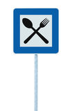 Restaurant sign post pole, traffic road roadsign, blue isolated dinner bar catering fork spoon roadside signage Royalty Free Stock Photos