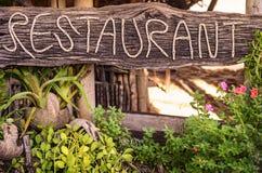 Restaurant sign on Thailand beach Royalty Free Stock Photos