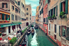 Restaurant on small canal in Venice, Italy. Stock Image
