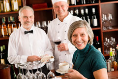Restaurant smiling manager with staff wine bar. Restaurant smiling menager have break with staff wine bar royalty free stock images
