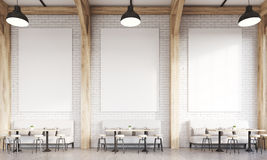 Restaurant with sofas. Front view of restaurant interior with sofas, chairs and tables. Concept of eating in public places. 3d rendering. Mock up Stock Photos