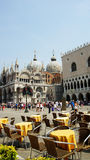 Restaurant in St. Marco Square, Venice, Italy. Cathedral and Doge's palace at the background Royalty Free Stock Image