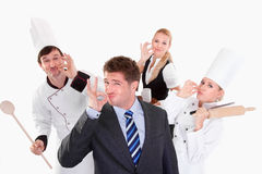 Restaurant staff. Happy people posing in studio Royalty Free Stock Photography
