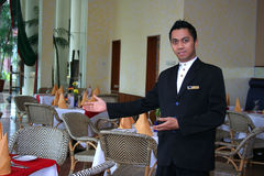 Restaurant staff or waiter. Restaurant staff with welcome style at work royalty free stock image