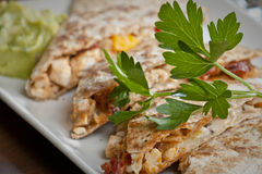 Restaurant Style Quesadilla. A restaurant style plating of a chicken quesadilla Stock Photo