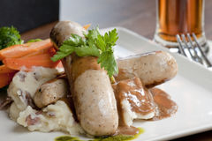 Restaurant Style Sausage Plate. A restaurant style plating of old pub style classic bangers and mashed Royalty Free Stock Photo