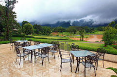 Restaurant surround by mist lake and mountains Royalty Free Stock Photography