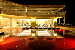 Restaurant and swimming pool in night illumination Royalty Free Stock Image