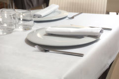 Restaurant table. For six with dishes, glasses, napkins and silverware Stock Photo