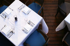 Restaurant table. And white tablecloth Royalty Free Stock Photo