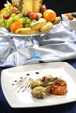 Restaurant table. With meat and fruits Royalty Free Stock Images