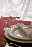 Restaurant table arrangement. Focus is on glasses Royalty Free Stock Images