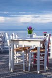 Restaurant table on the beach Stock Photos