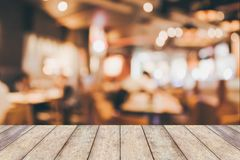 Restaurant cafe interior with people abstract blur background. Restaurant table in cafe or coffee shop interior with people abstract defocused blur background Royalty Free Stock Images
