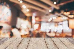 Coffee shop interior with people blur background. Restaurant table in cafe or coffee shop interior with people abstract defocused blur background Stock Image