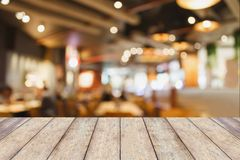 Coffee shop interior with people blur background. Restaurant table in cafe or coffee shop interior with people abstract defocused blur background Royalty Free Stock Image