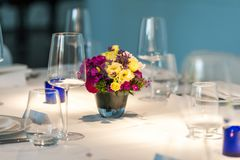 Restaurant table decoration with flower bouquet stock photos