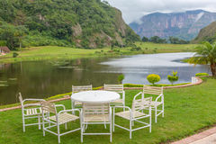 Restaurant table with empty chairs in nature Stock Photos