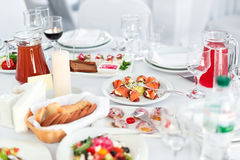 Restaurant table with food. Tasty appetizers, salads. Different meals for the guests on the wedding table