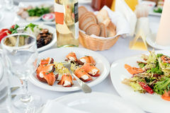 Restaurant table with food. Tasty appetizers, salads. Different meals for the guests on the wedding table.  royalty free stock photo