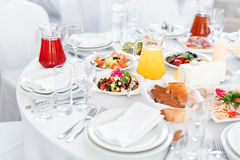 Restaurant table with food. Tasty appetizers, salads. Different meals for the guests on the wedding table.  stock photography