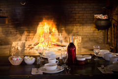 Restaurant table in front fire. Royalty Free Stock Images