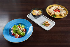 Restaurant table full of delicious food Royalty Free Stock Photography