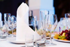 Restaurant table with glasses and napkins Stock Photography