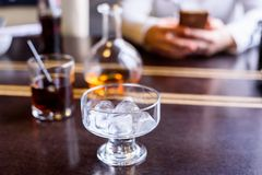Restaurant table with ice cubes in glass. Close up glass with ice cubes on restaurant table Stock Photo