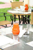 Restaurant table with jug. Of juice #1 Royalty Free Stock Photo