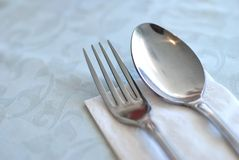 Restaurant table layout. Table layout in a restaurant or hotel with utensils before a meal. Suitable for generic concepts such as food and beverage, health and Royalty Free Stock Photo