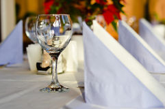 Restaurant table layout with row of wineglasses Stock Image