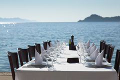 Restaurant table next to the sea. Spread table near to the sea, with excelent view Royalty Free Stock Photo
