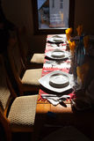 Restaurant table with plates. In sunlight Royalty Free Stock Images