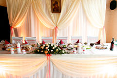 Restaurant table prepared for a wedding couple dressed in peach Royalty Free Stock Photography