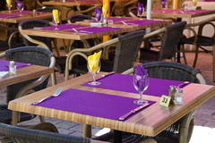 Restaurant table with purple placemat Royalty Free Stock Photos