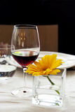 Restaurant table - Red wine and yellow flower Stock Images