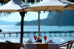 Restaurant table by the sea Stock Photos