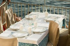 Restaurant table by the sea Royalty Free Stock Image