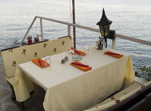 Restaurant table by the sea Royalty Free Stock Photography