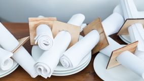 Restaurant table setting napkin arrangement decor. Restaurant table setting equipment. Creative napkin arrangement. Table decor Stock Image