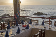 Restaurant table setting by the ocean Stock Photo