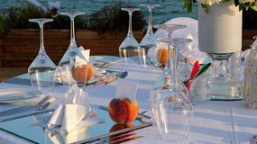 Restaurant Table Setting by the Sea Royalty Free Stock Photos