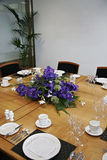 Restaurant table setup with cut flowers. Restaurant table setup with purple cut flowers Royalty Free Stock Photo