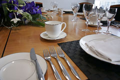 Restaurant table setup with cut flowers Royalty Free Stock Image
