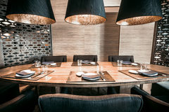 Restaurant with table and tableware. Interior modern restaurant with table, chairs and tableware Stock Images