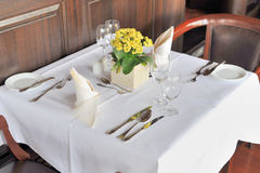 Restaurant table for two. A restaurant table elegantly set for fine dining for two Royalty Free Stock Photo