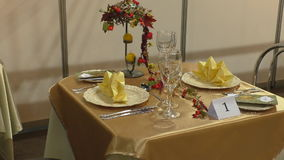 Restaurant table for two. Nicely decorated small table for two without people at a restaurant or cafe stock video footage