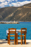 Restaurant table with a view of Vassiliki pier, Lefkada Stock Images