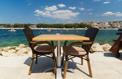 Restaurant table waiting for customers by the Adriatic sea Royalty Free Stock Photos